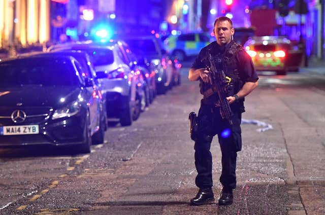 Armed police on Borough High Street at London Bridge, where a terrorist attack took place. (Dominic Lipinski/PA)