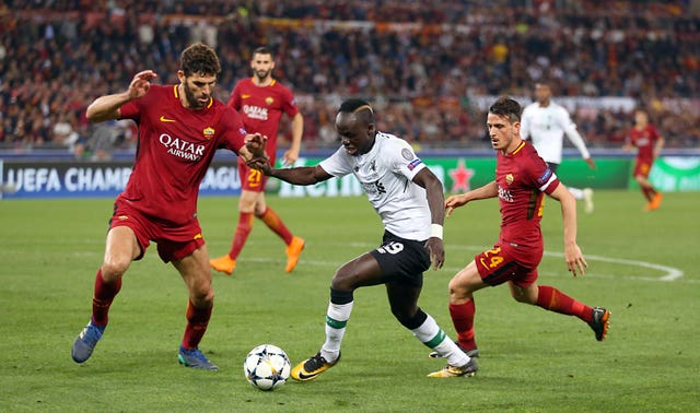 Roma's Federico Fazio (left) in Champions League action against Liverpool. (Steven Paston/PA)