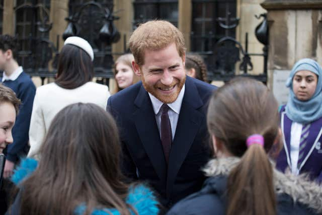 Prince Harry meets school children in Dean's Yard after the Commonwealth Service at Westminster Abbey (Jack Hill/The Times/PA)