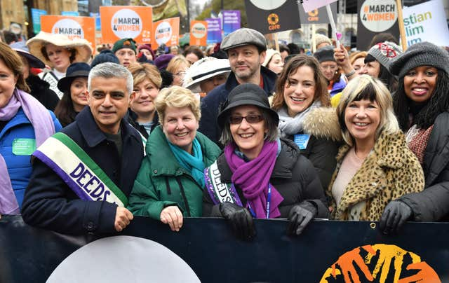 Marchers including Mr Khan, Toksvig, Michael Sheen and Helen Pankhurst, fourth right with purple scarf, gather outside the Palace of Westminster (Dominic Lipinski/PA)