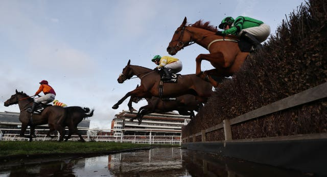 Carole's Destrier (centre yellow) on his way to victory at Newbury