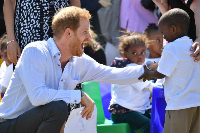 The Duke of Sussex arrives at the Nyanga Township in Cape Town, South Africa, for a visit to a workshop that teaches children about their rights, self-awareness and safety, on the first day of their tour of Africa