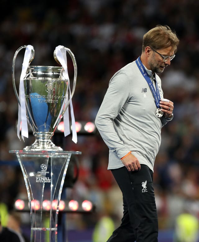 What might have been for Jurgen Klopp as he walks past the Champions League trophy after collecting his loser's medal
