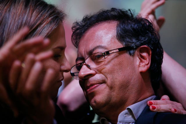 Gustavo Petro is embraced by his wife Veronica Alcocer after addressing supporters (AP Photo/Juan Manuel Barrero)