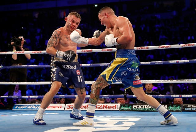 Josh Warrington, right, prevailed after a bruising battle against Carl Frampton (Martin Rickett/PA)