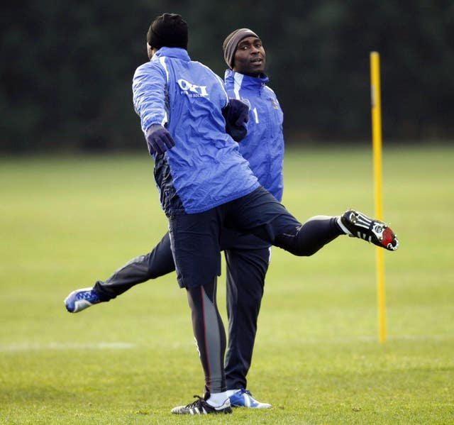 Sol Campbell (left) has attracted his former Portsmouth team-mate Andy Cole to Macclesfield (Chris Ison/PA).