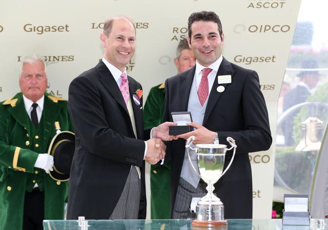 The Earl of Wessex presents the prize for the Duke of Cambridge Stakes to Marco Botti