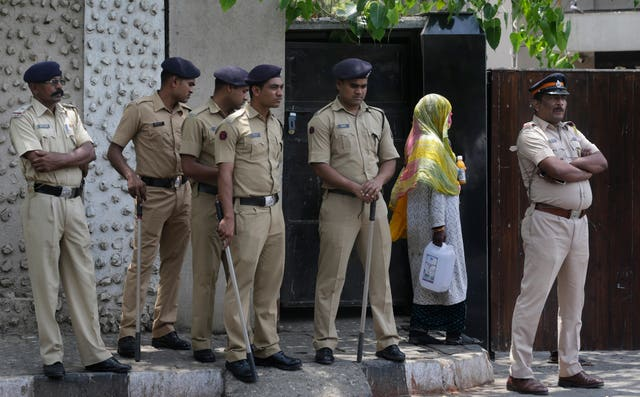 Police stand guard outside the house of Bollywood star Salman Khan in Mumbai (Rafiq Maqbool/AP)