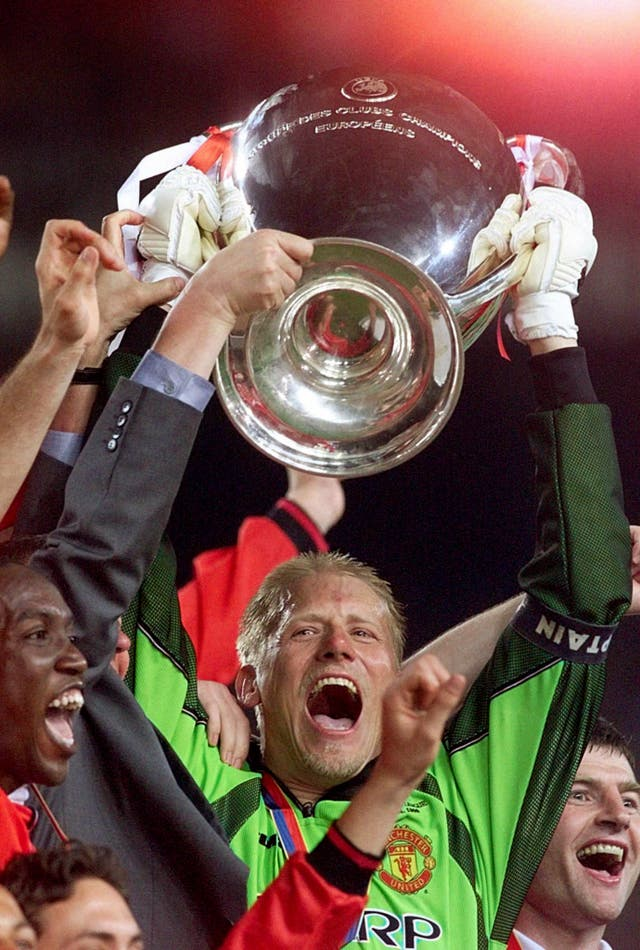 Peter Schmeichel lifts the Champions League aloft (Phil Noble/PA)