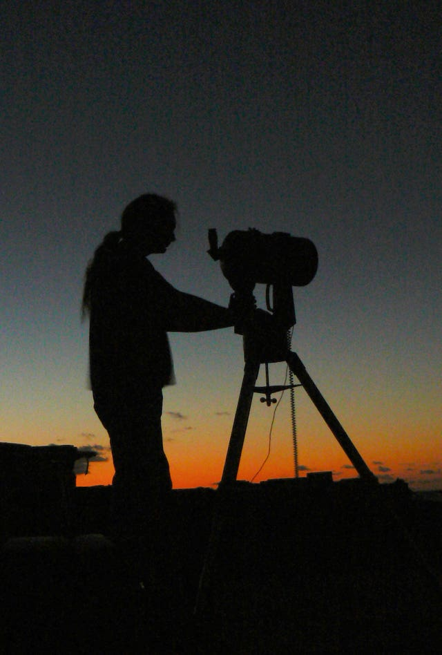 A member of Basingstoke Astronomical Society using a telescope