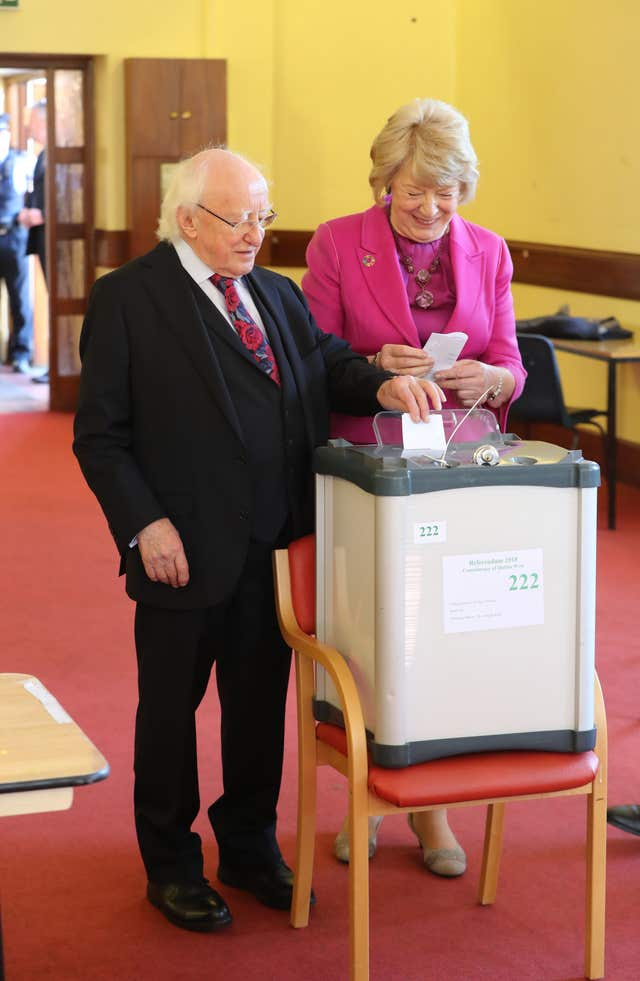 President Michael D Higgins and his wife Sabina casting their votes (Niall Carson/PA)