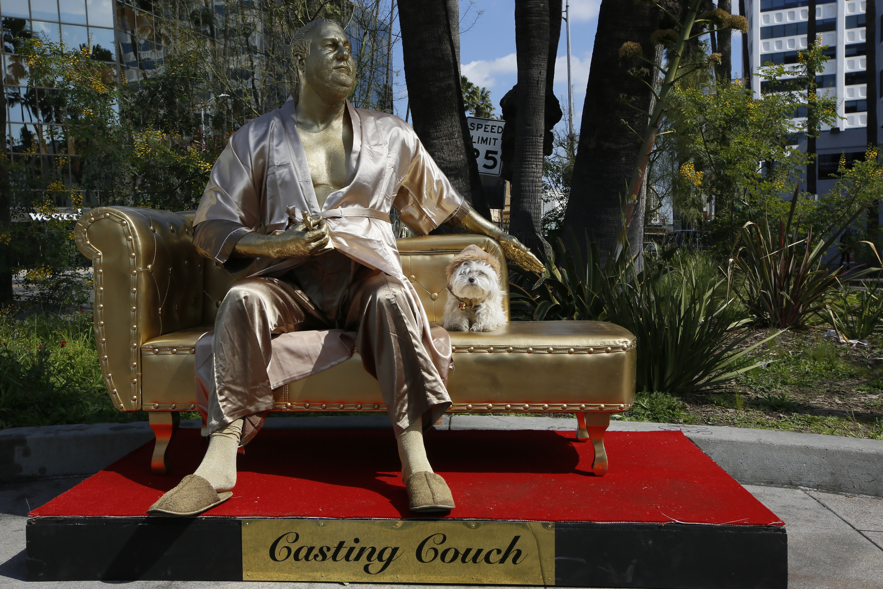 Bathrobe-clad golden Harvey Weinstein statue pops up in Los Angeles