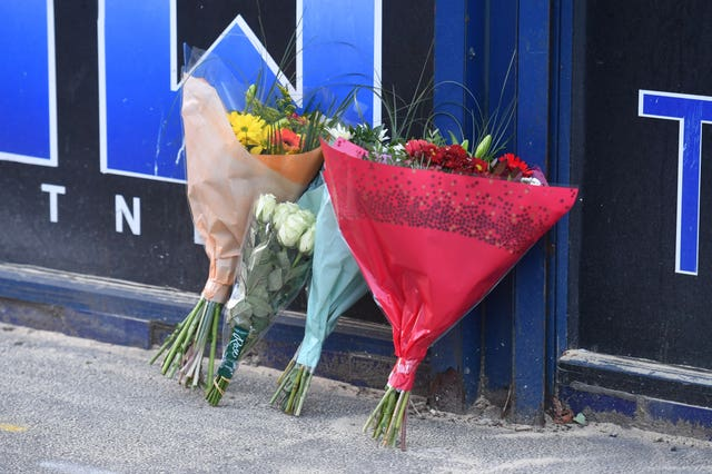Flowers at the scene of the stabbing (John Stillwell/PA)