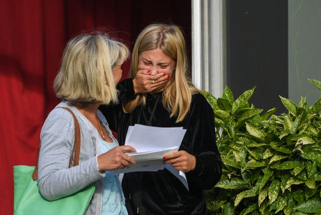 Lara Wells celebrates with her mum Emma after collecting her results at Norwich School