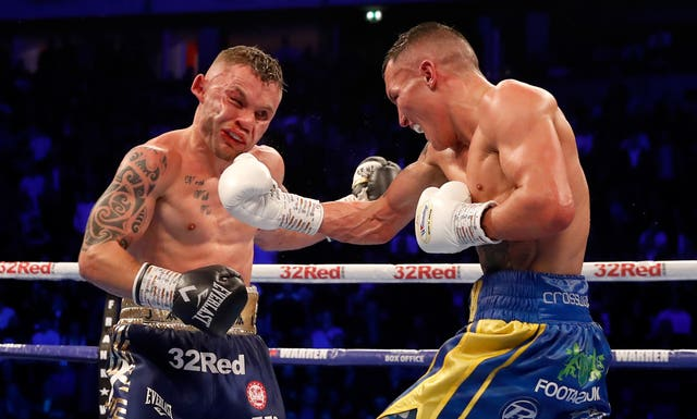 Josh Warrington, right, prevailed after a bruising 12-round battle with Carl Frampton (Martin Rickett/PA)
