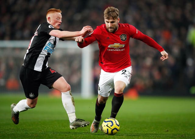 Luke Shaw, right, has expressed his reservations about playing matches behind closed doors