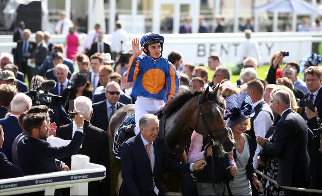 Donnacha O'Brien and Forever Together return to the winner's enclosure after winning the Investec Oaks