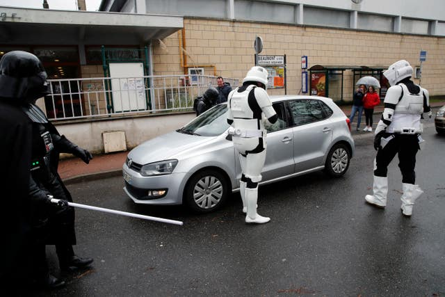 Men dressed as stormtroopers during a national lightsabre tournament in Beaumont-sur-Oise, north of Paris