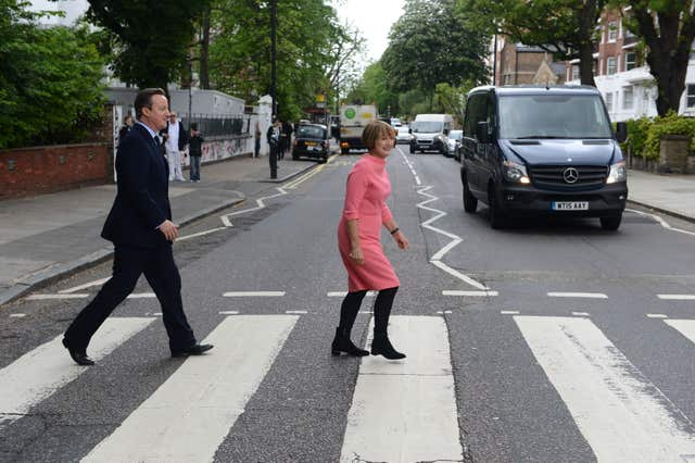 Prime Minister David Cameron with Labour's former culture secretary Tessa Jowell trying to recreate the famous Beatles album cover during their visit to Abbey Road studios in north London in 2016 (Jeremy Selwyn/Evening Standard)