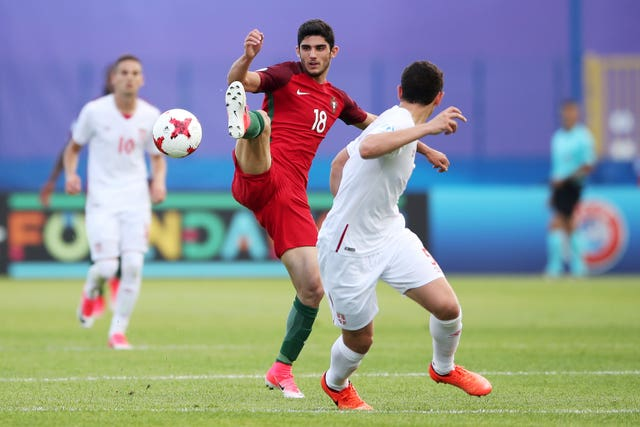 Portugal's Goncalo Guedes (left)