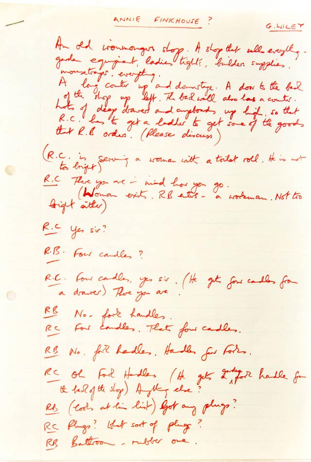 The Two Ronnies' 'Fork Handles' script written in red ink.