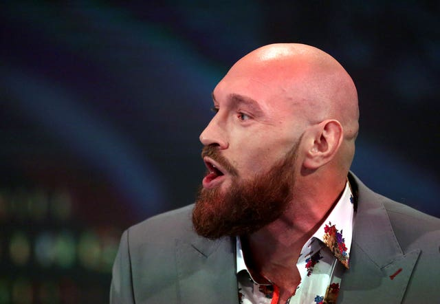 Tyson Fury claims Deontay Wilder is running scared (Steven Paston/PA).