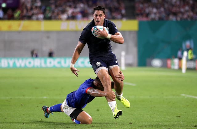 Sean Maitland breaks a tackle to score Scotland's first try