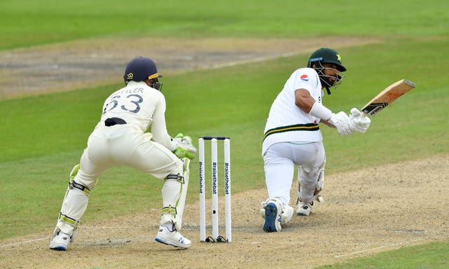 Shan Masood hits the ball for four on day two