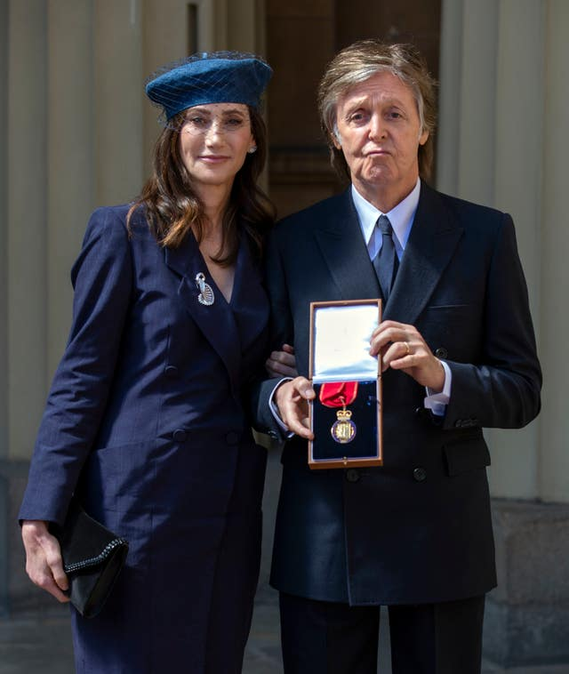 Sir Paul McCartney and his wife Nancy Shevell following an Investiture ceremony at Buckingham Palace (Steve Parsons/PA)
