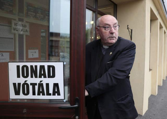 Father Tom Harrington arrives at the polling station at Knock National school, Mayo, as the country goes to the polls (Brian Lawless/PA)