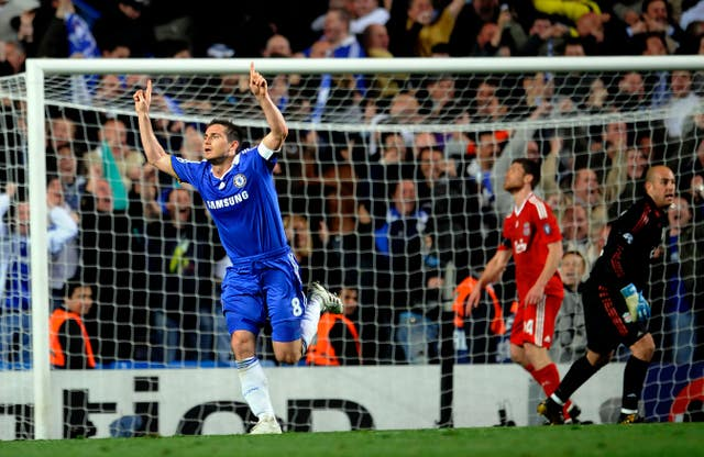 Frank Lampard, left, celebrates scoring against Liverpool