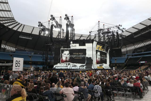 Crowds gather to watch Taylor Swift on stage as she opens her Reputation stadium tour at the Eitihad Stadium, Manchester.