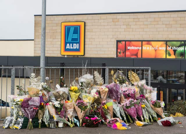 Floral tributes outside an Aldi supermarket in Skipton where Jodie Willsher was stabbed to death (Danny Lawson/PA)