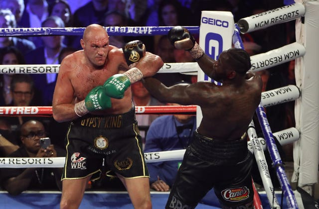 Tyson Fury, left, insists he will fight Deontay Wilder next (Bradley Collyer/PA)