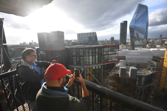 People take pictures from the viewing platform at Tate Modern