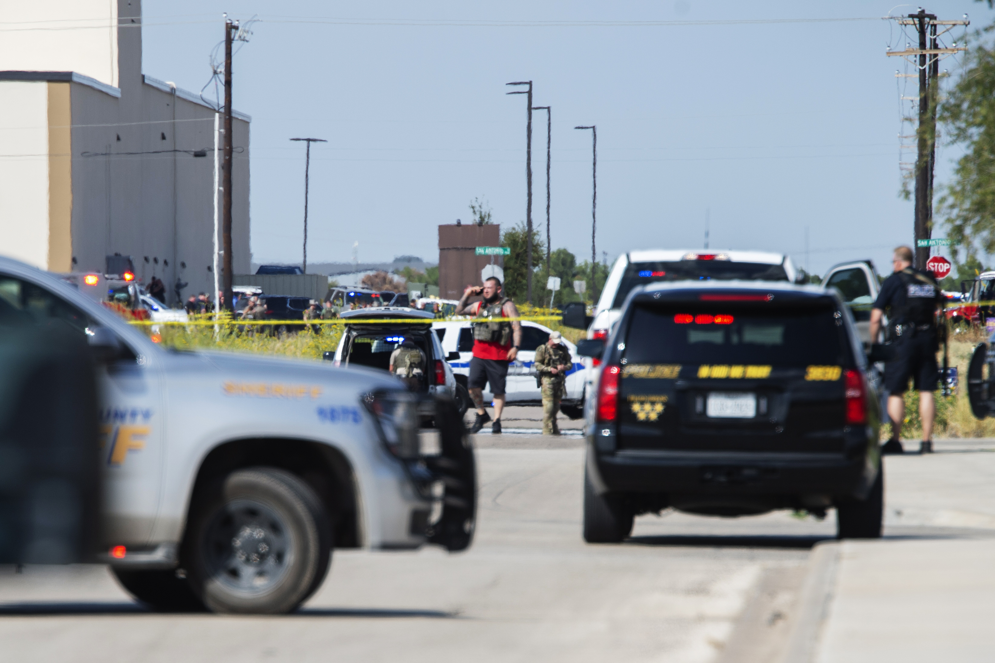 Odessa and Midland police and sheriff's deputies surround the area behind Cinergy cinema in Odessa Texas