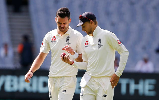 England's James Anderson and Joe Root inspect the ball during day five of the Ashes Test (Jason O'Brien/PA)
