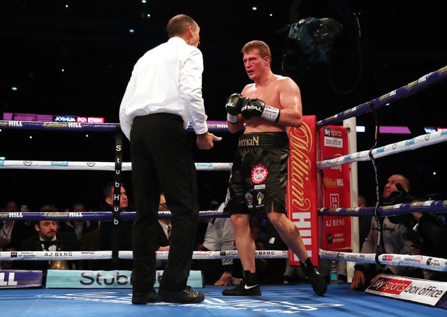 The referee checks on with Alexander Povetkin