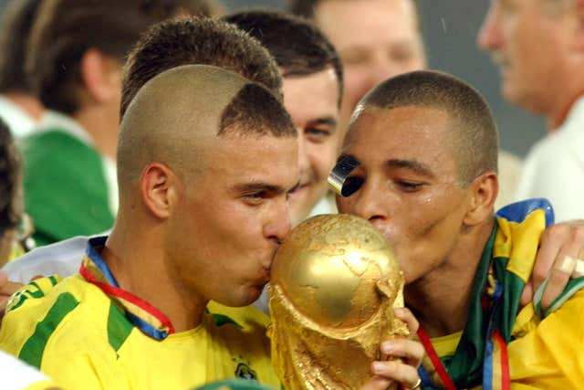 Ronaldo, pictured left, led Brazil to World Cup glory in 2002