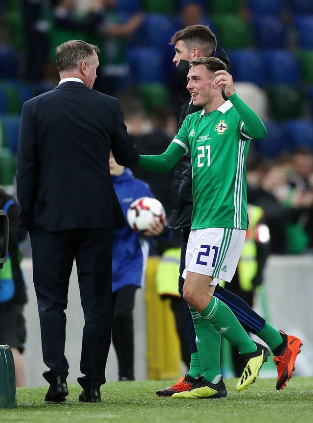 Northern Ireland manager Michael O'Neill congratulates Gavin Whyte on his debut goal (Liam McBurney/PA).