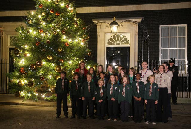 Sarah Brown, the wife of Prime Minister Gordon Brown, and a group of Guides turn on the Christmas tree lights in Downing Street,