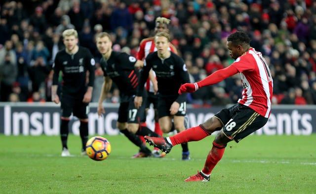 Jermain Defoe, right, scores a Sunderland penalty against Liverpool