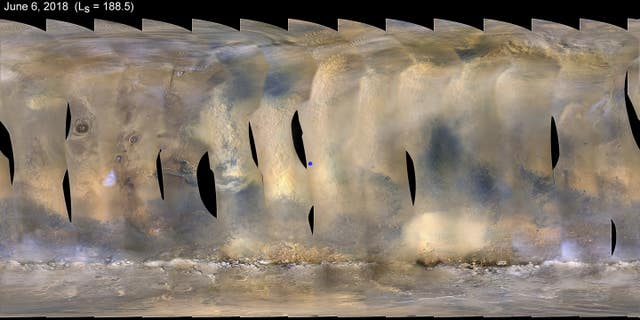 A global map of Mars with a growing dust storm