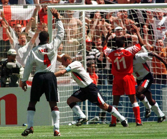 England captain Alan Shearer celebrates his goal against Tunisia