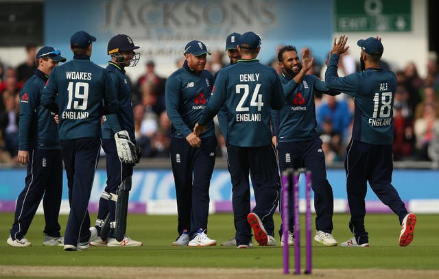 Adil Rashid, second right, is congratulated after his brilliant return catch removed Shoaib Malik