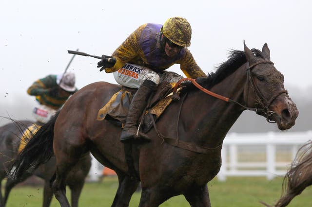 A mud-splattered Jack Quinlan and Kalashnikov on the way to winning the Betfair Hurdle at Newbury