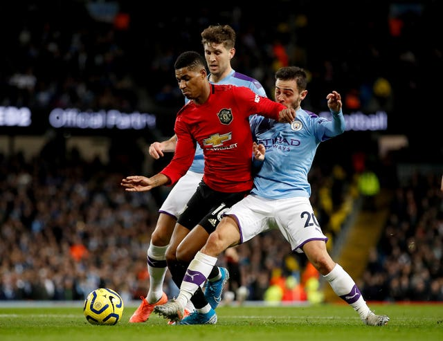 Manchester City's Bernardo Silva gave away a penalty by fouling Marcus Rashford who scored Manchester United's opening goal in his side's 2-1 victory