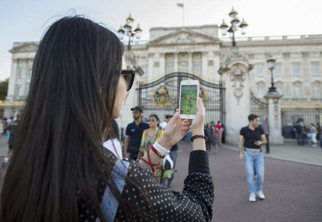 Pokemon Go being played outside Buckingham Palace