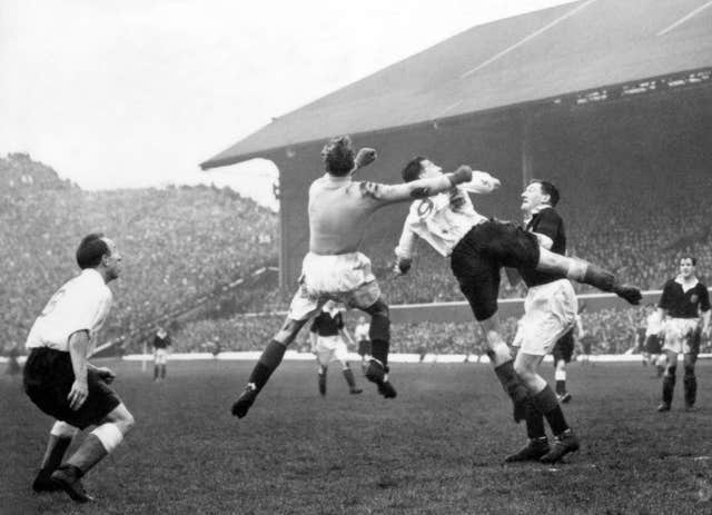 Scotland goalkeeper Bobby Brown beats England's Nat Lofthouse to the ball