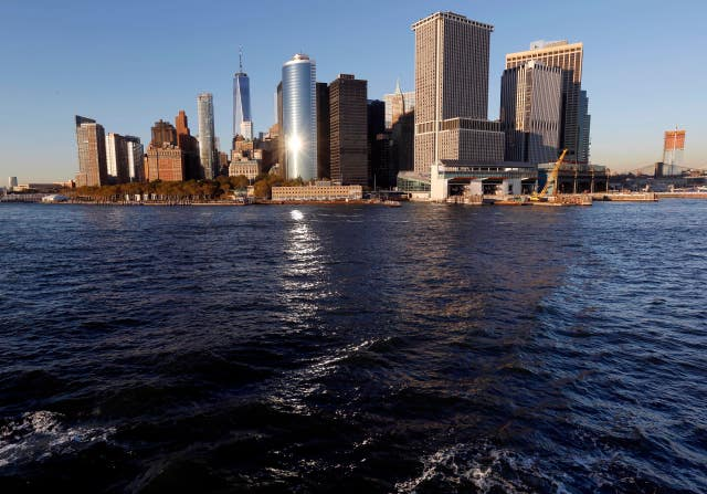 Water from New York Harbor surrounds the southern tip of New York's Manhattan borough (Seth Wenig/AP)